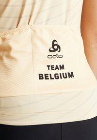 ODLO - WOMEN STAND-UP COLLAR FULL ZIP PERFORMANCE - T-Shirt print - golden haze - 4