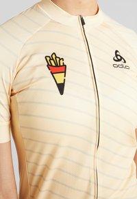 ODLO - WOMEN STAND-UP COLLAR FULL ZIP PERFORMANCE - T-Shirt print - golden haze - 6