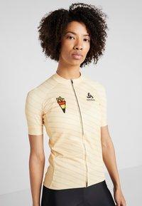 ODLO - WOMEN STAND-UP COLLAR FULL ZIP PERFORMANCE - T-Shirt print - golden haze - 0