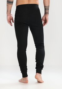 ODLO - PANTS LONG WARM - Långkalsonger - black - 2
