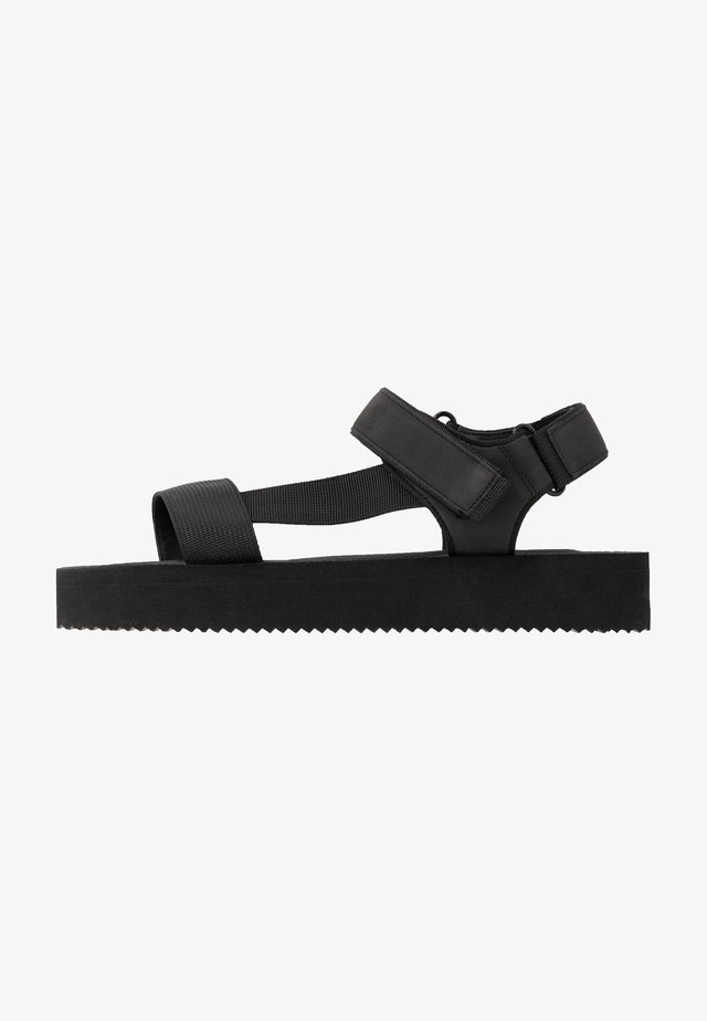 SPRINGY - Platform sandals - black