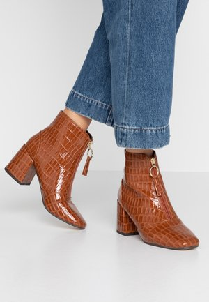 ABIR - Ankle boots - chocolate