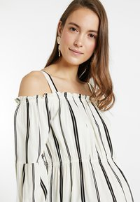 ohma! - STRIPPED BLOUSE WITH DETACHABLE STRAPS - Bluser - white/black - 3