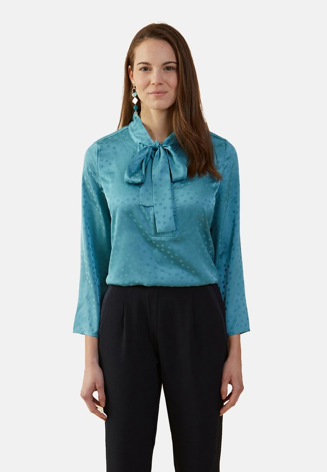 MIT PUNKTMUSTER - Blouse - turquoise