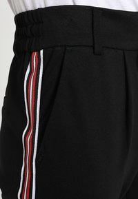 ONLY - ONLPOPTRASH EASY SPORT PANT - Tracksuit bottoms - black/red/white - 5