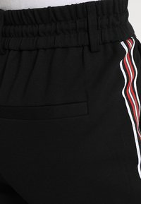 ONLY - ONLPOPTRASH EASY SPORT PANT - Tracksuit bottoms - black/red/white