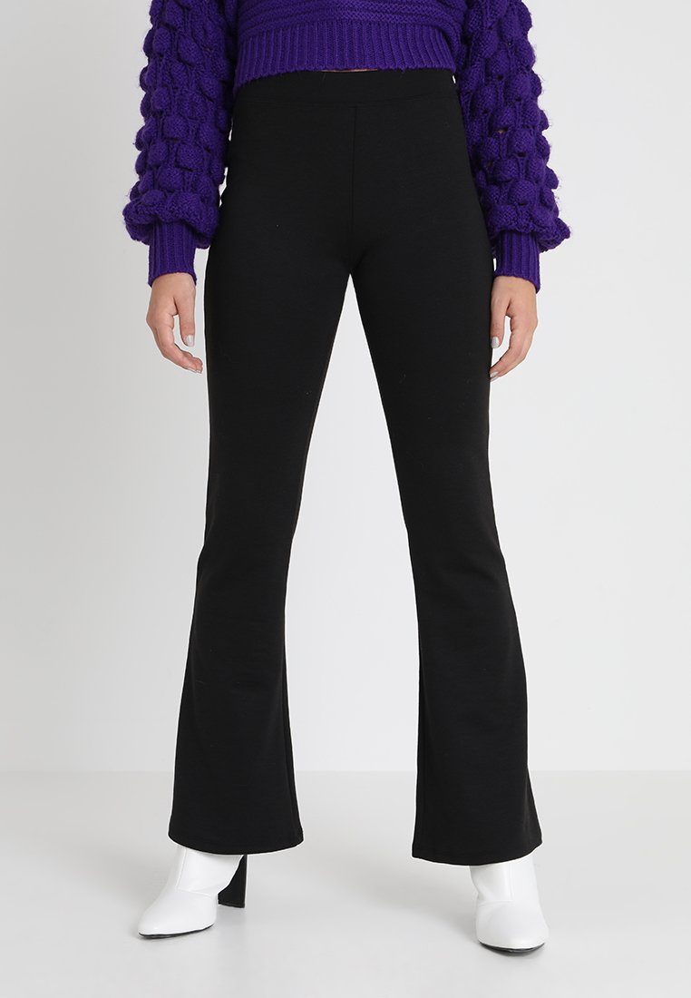 ONLY - ONLFEVER FLARED PANTS - Stoffhose - black