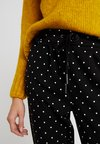 ONLY - ONLPOPTRASH EASY DOT PANT - Trousers - black/white