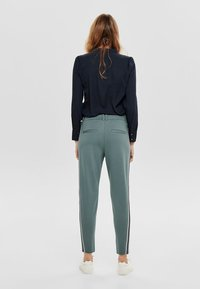 ONLY - Tracksuit bottoms - balsam green - 2