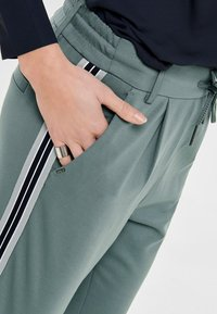 ONLY - Tracksuit bottoms - balsam green - 3