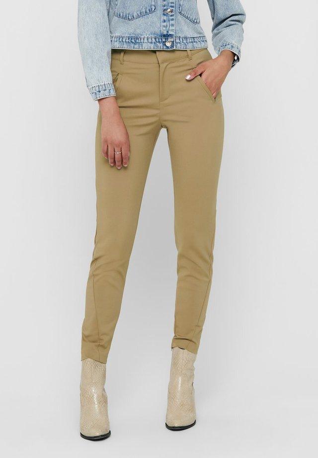 ONLSTRIKE  - Pantalones - beige