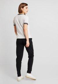 ONLY - ONLTRINE PANTS - Tracksuit bottoms - black - 2
