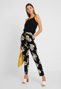 ONLY - ONLNOVA PANT - Trousers - black/yellow - 1