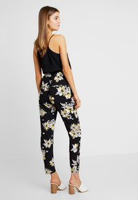 ONLY - ONLNOVA PANT - Trousers - black/yellow - 2