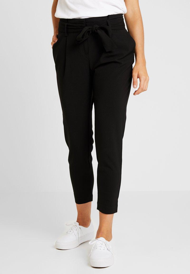 ONLY - ONYTINI PAPERBAG PANTS - Stoffhose - black