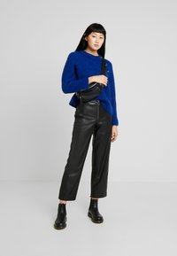 ONLY - ONLHANNAH WIDE FIT PANTS - Trousers - black - 1