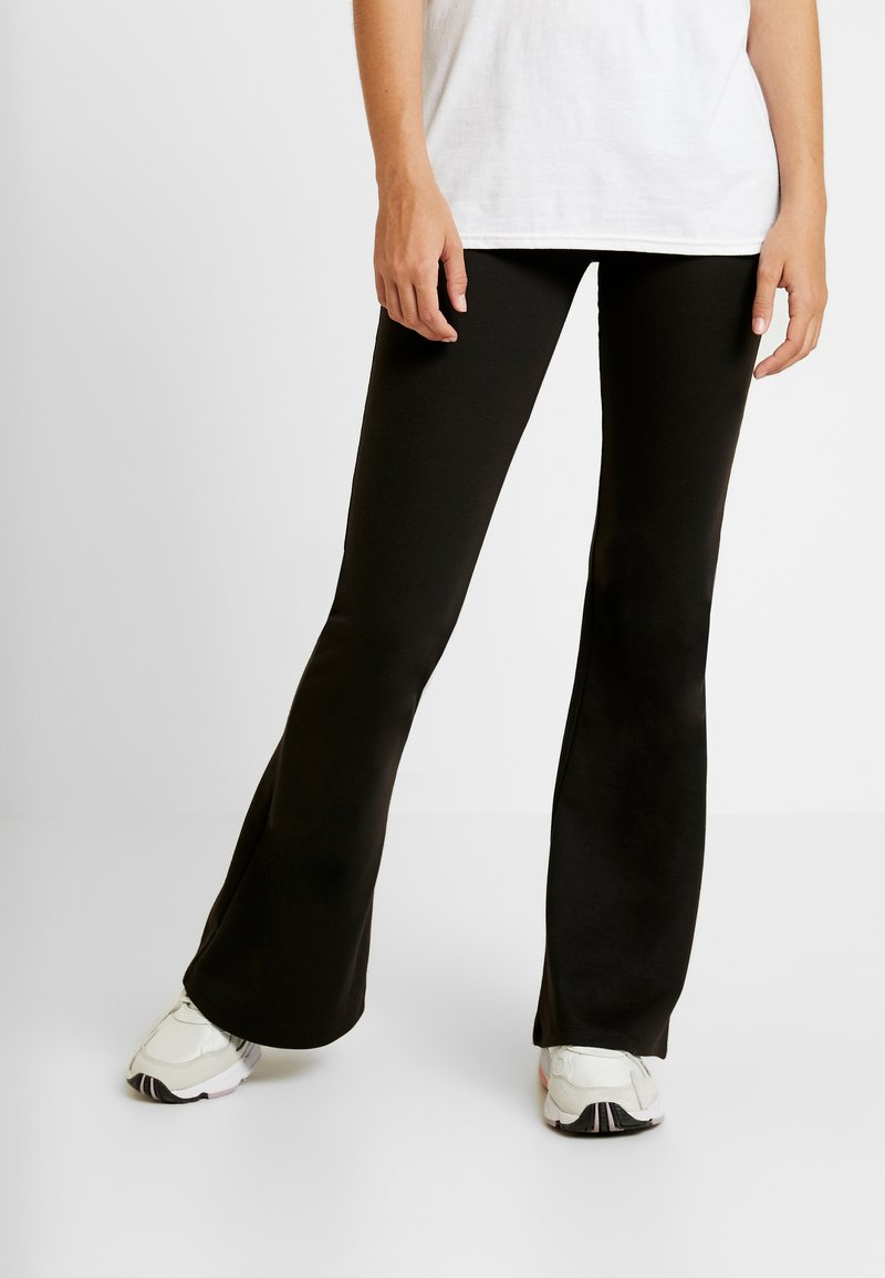 ONLY - ONLFEVER FLAIRED PANTS - Træningsbukser - black