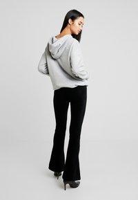 ONLY - ONLFENJA FLARED PANT - Bukse - black - 2