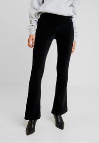 ONLY - ONLFENJA FLARED PANT - Bukse - black - 0