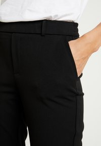 ONLY - ONLGINA KAYA PANTS - Trousers - black - 4
