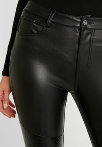 ONLY - ONLLOMO BIKER PANTS - Bukse - black - 4