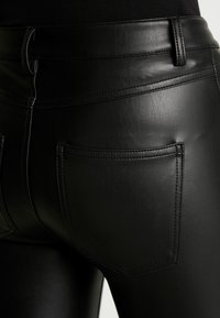 ONLY - ONLLOMO BIKER PANTS - Bukse - black - 6