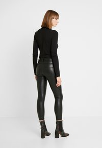 ONLY - ONLLOMO BIKER PANTS - Bukse - black - 3