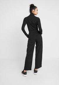 ONLY - ONLMARTA ROCKY WIDE PANTS - Teplákové kalhoty - black - 2