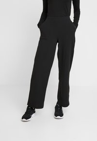 ONLY - ONLMARTA ROCKY WIDE PANTS - Teplákové kalhoty - black - 0