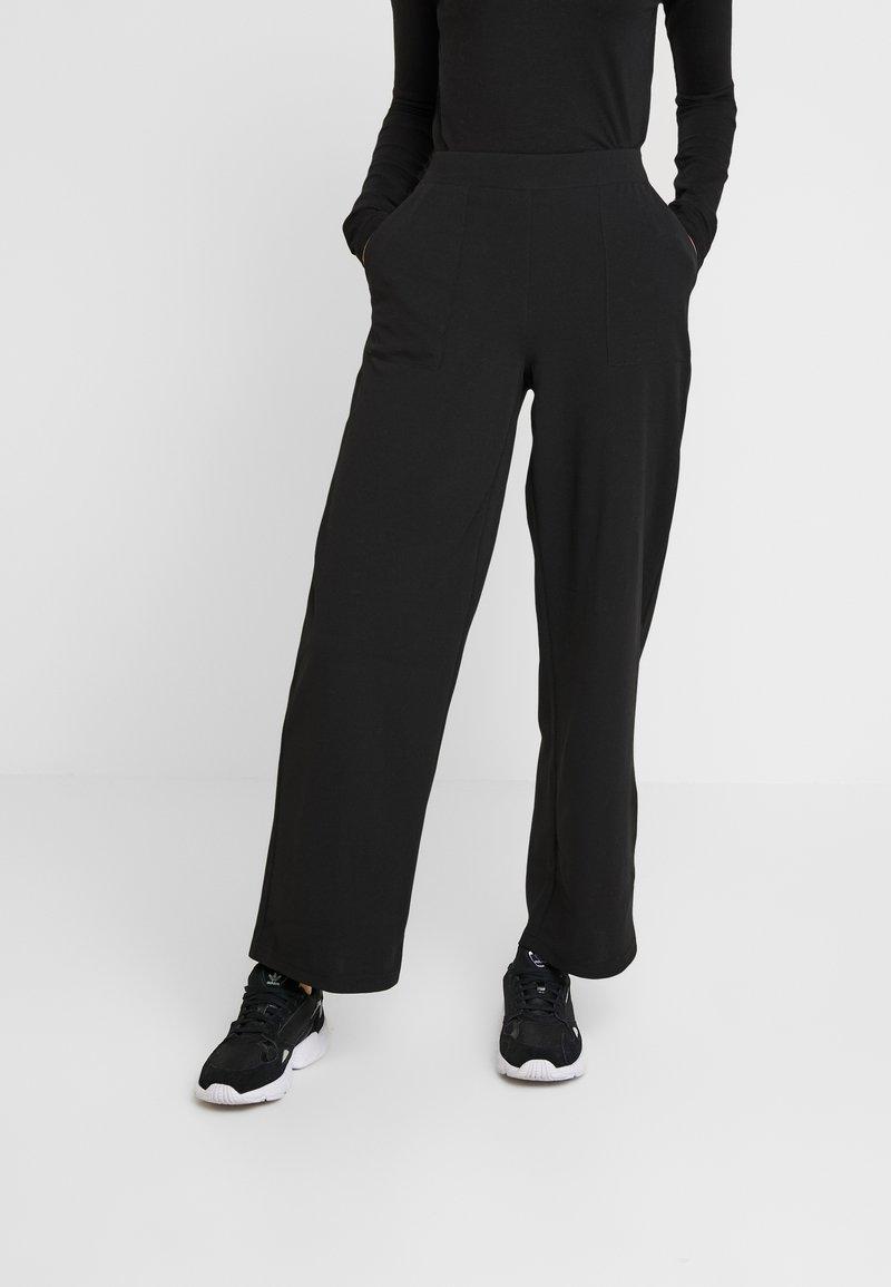 ONLY - ONLMARTA ROCKY WIDE PANTS - Pantaloni sportivi - black