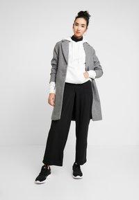 ONLY - ONLMARTA ROCKY WIDE PANTS - Teplákové kalhoty - black - 1