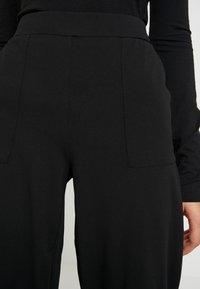 ONLY - ONLMARTA ROCKY WIDE PANTS - Teplákové kalhoty - black - 4