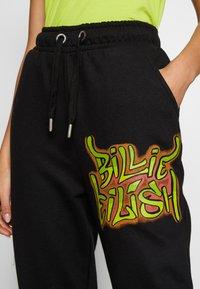 ONLY - ONLBILLIE EILISH PANTS - Tracksuit bottoms - black - 4
