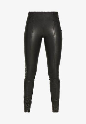 ONLTIA SUPERSTAR - Leggings - Trousers - black