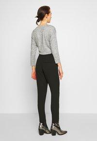 ONLY - ONLNOVA LUX PANT SOLID - Pantalones - black - 2