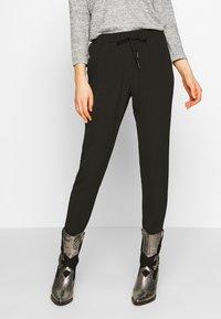 ONLY - ONLNOVA LUX PANT SOLID - Pantalones - black - 0