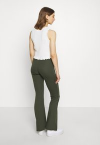 ONLY - ONLFEVER STRETCH FLAIRED PANTS - Trousers - forest night - 2