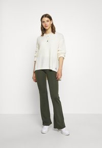 ONLY - ONLFEVER STRETCH FLAIRED PANTS - Trousers - forest night - 1