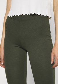 ONLY - ONLFEVER STRETCH FLAIRED PANTS - Trousers - forest night - 4