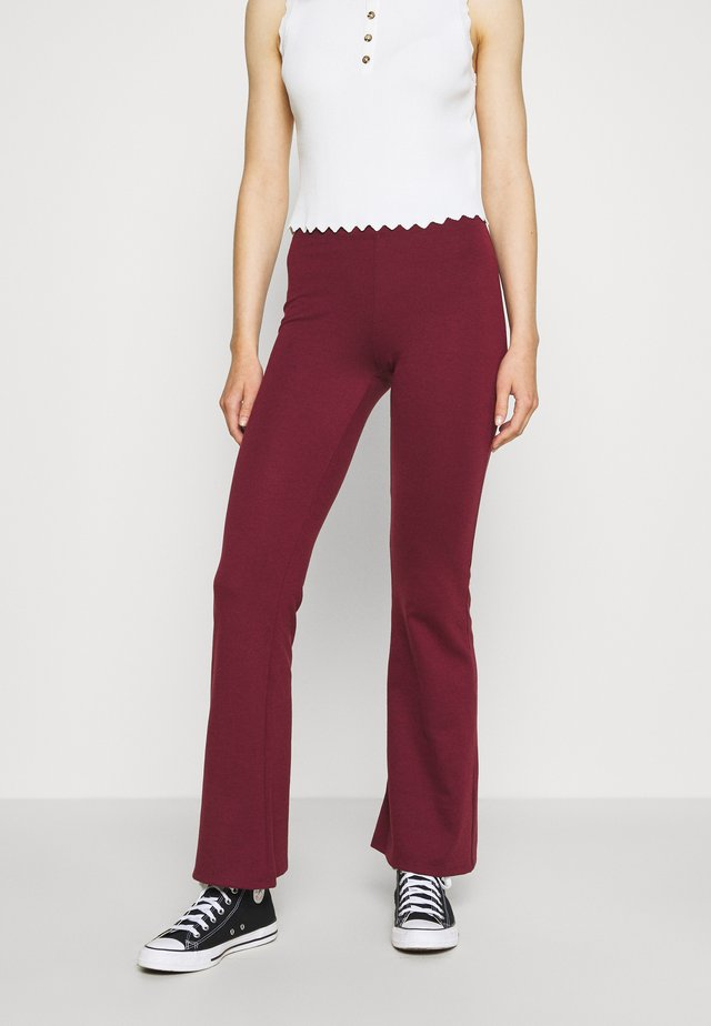 ONLFEVER STRETCH FLAIRED PANTS - Pantalones - tawny port