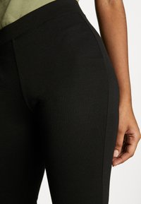 ONLY - ONLFEVER STRETCH FLAIRED PANTS - Trousers - black - 5