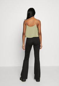 ONLY - ONLFEVER STRETCH FLAIRED PANTS - Trousers - black - 3