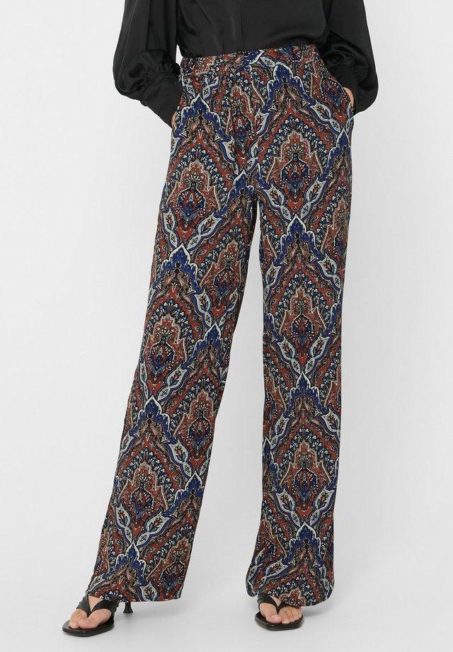 Pantalones - burnt henna