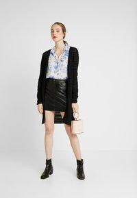 ONLY - ONLNORMA SKIRT - Minifalda - black - 1