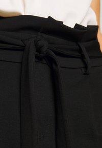 ONLY - ONLPOPTRASH EASY PAPERBAG SKIRT - Minirok - black - 4