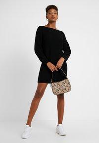 ONLY - ONLATTILANA DRESS - Pletené šaty - black - 2