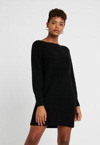 ONLY - ONLATTILANA DRESS - Pletené šaty - black - 0