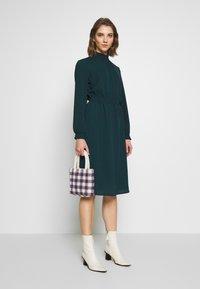 ONLY - ONLNOVA SMOCK HIGH DRESS  - Kjole - black - 1