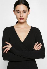 ONLY - ONLSALLY WRAP DRESS  - Trikoomekko - black - 3