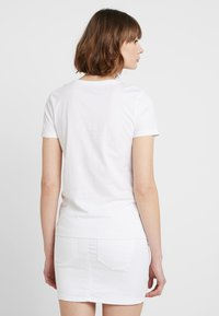 ONLY - T-shirt con stampa - bright white - 2